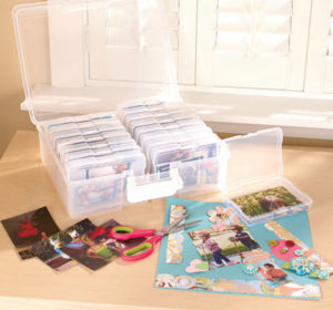 Use a photo-sorting box. Make it easy on yourself to organize your photos once and for all.